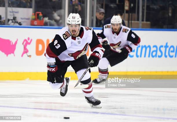 Conor Garland of the Arizona Coyotes races for the puck during their game against the New York Rangers at Madison Square Garden on October 22 2019 in...
