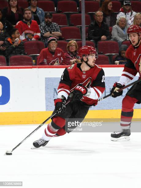 Conor Garland of the Arizona Coyotes skates with the puck against the Florida Panthers at Gila River Arena on February 25 2020 in Glendale Arizona