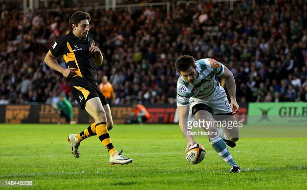 Conor Gaston of London Irish touches down a try ahead of JAck Wallace of Wasps during the JP Morgan Asset Management Premiership Rugby 7s match...