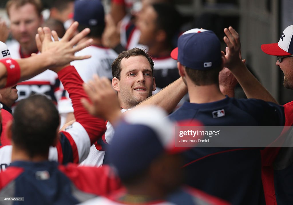 Conor Gillaspie #12 of the Chicago White Sox is greeted by teammates in the dugout after hitting a grand slam home run in the 1st inning against the Toronto Blue Jays at U.S. Cellular Field on August 17, 2014 in Chicago, Illinois.