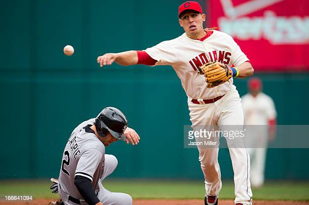 Conor Gillaspie of the Chicago White Sox is out at second as shortstop Asdrubal Cabrera of the Cleveland Indians throws to first during the third...