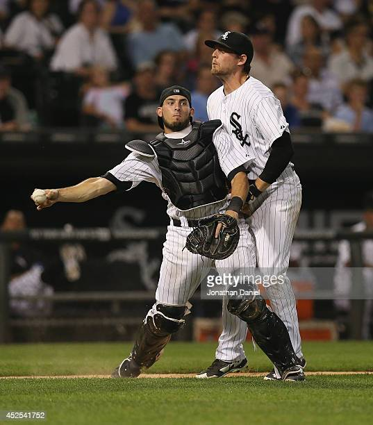 Conor Gillaspie of the Chicago White Sox runs into Adrian Nieto as Nieto tries to throw out Alcides Escobar of the Kansas City Royals at US Cellular...