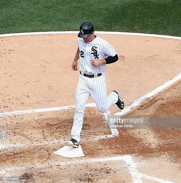Conor Gillaspie of the Chicago White Sox scores a run on a wild pitch in the 1st inning against the Seattle Mariners at US Cellular Field on July 6...