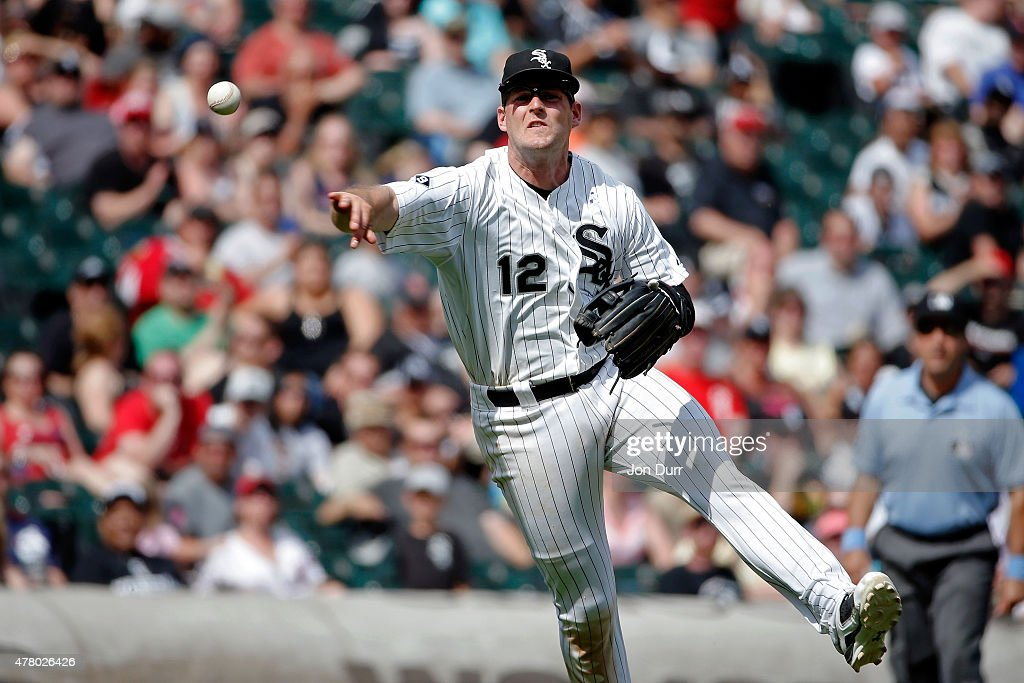 Conor Gillaspie #12 of the Chicago White Sox throws to first base for the out against the Texas Rangers during the eighth inning at U.S. Cellular Field on June 21, 2015 in Chicago, Illinois. The Chicago White Sox won 3-2 in eleven innings.
