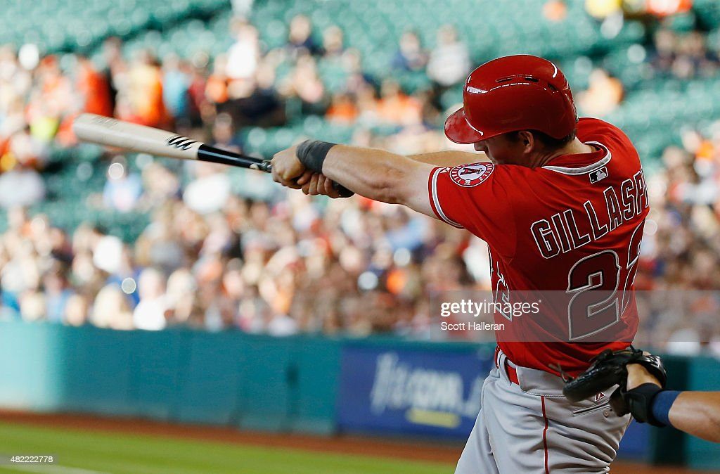 Conor Gillaspie #22 of the Los Angeles Angels of Anaheim connects on an RBI double in the first inning during their game against the Houston Astros at Minute Maid Park on July 28, 2015 in Houston, Texas.