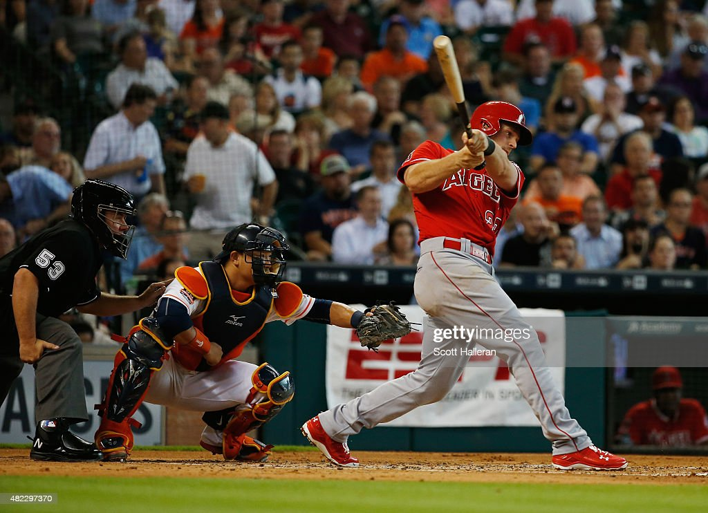 Conor Gillaspie #22 of the Los Angeles Angels of Anaheim connects on an RBI triple in the second inning during their game against the Houston Astros at Minute Maid Park on July 29, 2015 in Houston, Texas.