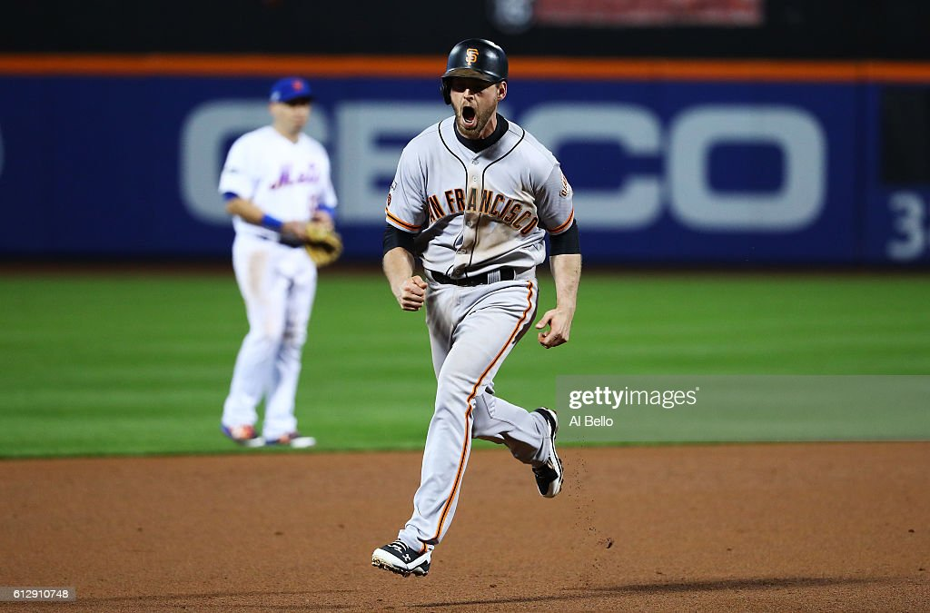 Conor Gillaspie #21 of the San Francisco Giants runs the bases as he celebrates his three-run homerun in the ninth inning against the New York Mets during their National League Wild Card game at Citi Field on October 5, 2016 in New York City.