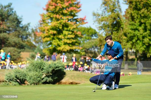 Conor Gough and Robin Williams of Team Europe line up a putt looks on during the foursomes on day one of the 2018 Junior Ryder Cup at Disneyland...
