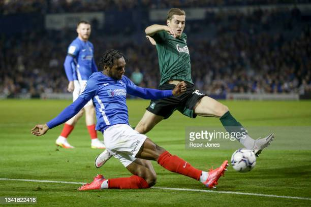 Conor Grant of Plymouth Argyle slides in to stop in to stop Mahlon Romeo of Portsmouth FC during the Sky Bet League One match between Portsmouth and...