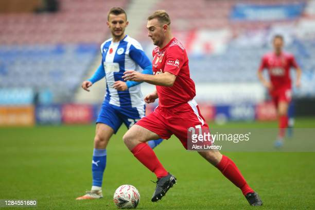 Conor Hall of Chorley FC runs with the ball during the FA Cup First Round match between Wigan Athletic and Chorley on November 08, 2020 in Wigan,...