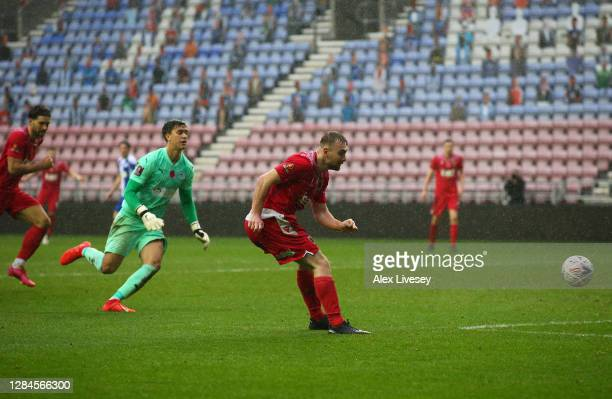 Conor Hall of Chorley FC scores his team's third goal during the FA Cup First Round match between Wigan Athletic and Chorley on November 08, 2020 in...