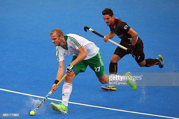 Conor Harte of Ireland avoids Tanguy Cosyns of Belgium during the match between Belgium and Ireland on day five of the Unibet EuroHockey...