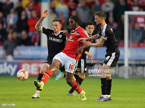 Conor Hourihane and Josh Brownhill of Barnsley challenge Romaine Sawyers of Walsall during the Sky Bet League One Play Off Second Leg between Walsall...