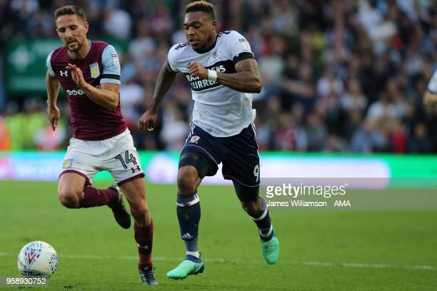 Conor Hourihane of Aston Villa and Britt Assombalonga of Middlesbrough during the Sky Bet Championship Play Off Semi FinalSecond Leg match between...