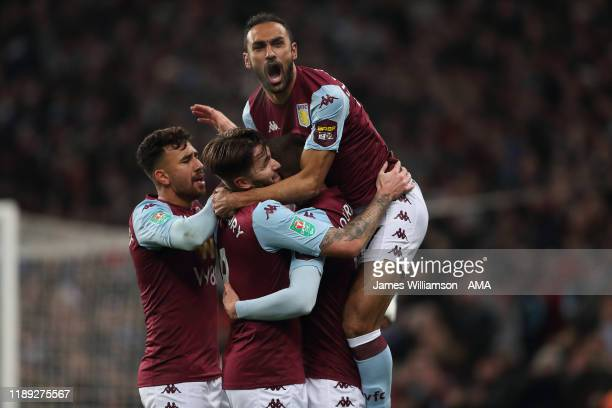 Conor Hourihane of Aston Villa celebrates after scoring a goal to make it 1-0 with teammates during the Carabao Cup Quarter Final match between Aston...