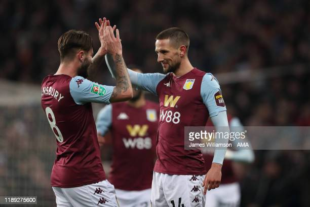 Conor Hourihane of Aston Villa celebrates after scoring a goal to make it 1-0 during the Carabao Cup Quarter Final match between Aston Villa and...