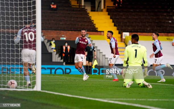 Conor Hourihane of Aston Villa celebrates after scoring his team's second goal during the Premier League match between Fulham and Aston Villa at...