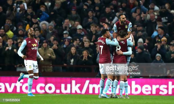 Conor Hourihane of Aston Villa celebrates scoring his teams first goal during the Carabao Cup Quarter Final match between Aston Villa and Liverpool...