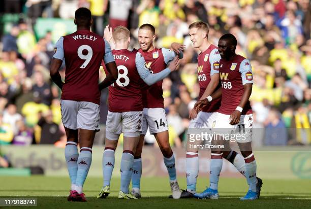 Conor Hourihane of Aston Villa celebrates with his team after he scores his sides fourth goal during the Premier League match between Norwich City...