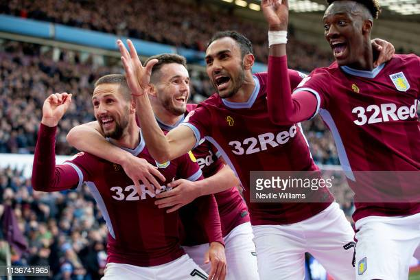 Conor Hourihane of Aston Villa celebrates with his team-mates after scoring during the Sky Bet Championship match between Aston Villa and Bristol...