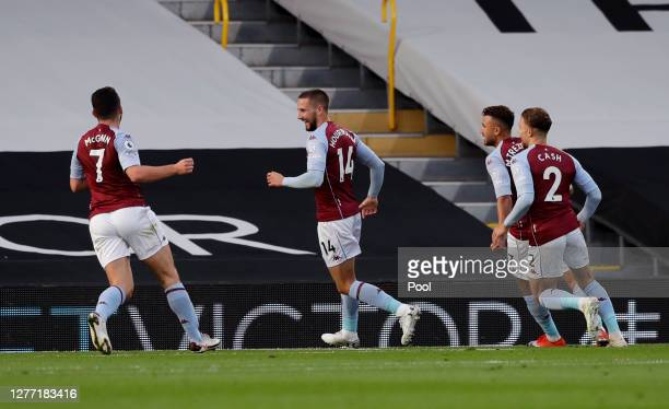 Conor Hourihane of Aston Villa celebrates with teammates after scoring his team's second goal during the Premier League match between Fulham and...