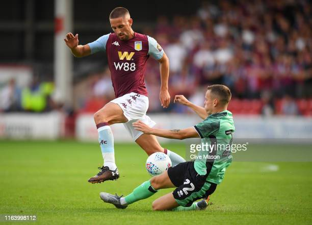 Conor Hourihane of Aston Villa is challenged by Liam Kinsella of Walsall during the Pre-Season Friendly match between Walsall and Aston Villa at...