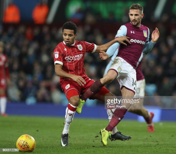 Conor Hourihane of Aston Villa is tackled by Korey Smith during the Sky Bet Championship match between Aston Villa and Bristol City at Villa Park on...