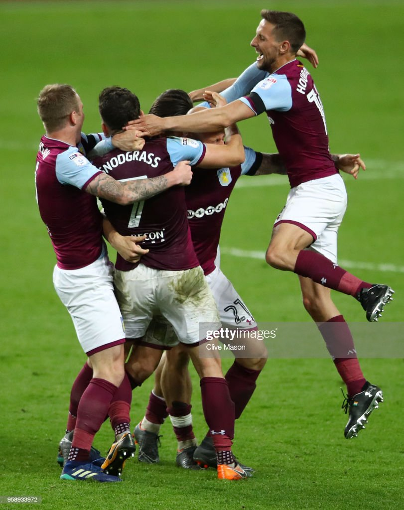 Conor Hourihane of Aston Villa , Robert Snodgrass of Aston Villa , Glenn Whelan of Aston Villa and Jack Grealish of Aston Villa celebrate at the full time whistle after the Sky Bet Championship Play Off Semi Final second leg match between Aston Villa and Middlesbrough at Villa Park on May 15, 2018 in Birmingham, England.