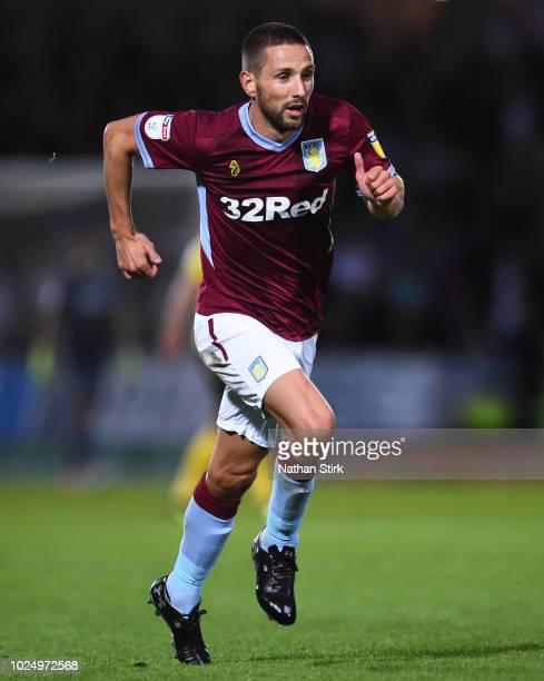 Conor Hourihane of Aston Villa runs for the ball during the Carabao Cup Second Round match between Burton Albion and Aston Villa at Pirelli Stadium...