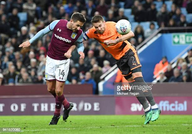 Conor Hourihane of Aston Villa scores his sides second goal while under pressure from Chris Gunter of Reading during the Sky Bet Championship match...