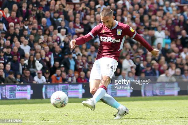 Conor Hourihane of Aston Villa scores his team's first goal during the Sky Bet Championship Play-off semi final first leg match between Aston Villa...