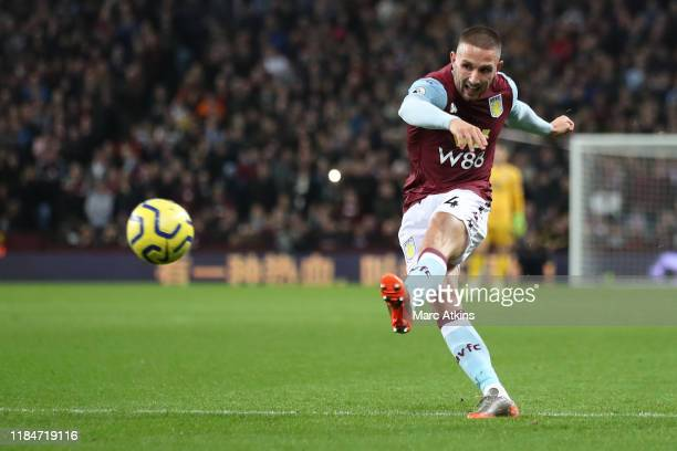 Conor Hourihane of Aston Villa scores the opening goal during the Premier League match between Aston Villa and Newcastle United at Villa Park on...