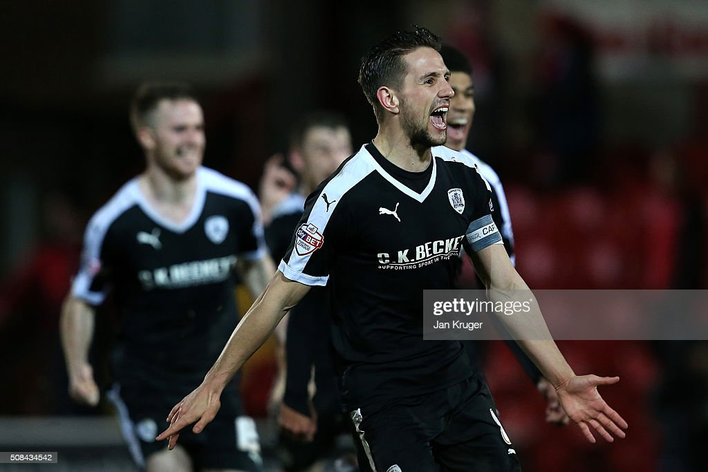 Conor Hourihane of Barnsley celebrates victory after a penalty shoot out with team mates during the Johnstone's Paint Trophy northern section semi final second leg match between Fleetwood Town and Barnsley at Highbury Stadium on February 4, 2016 in Fleetwood, England.