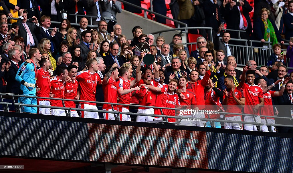 Conor Hourihane of Barnsley lifts the trophy as the Barnsley players celebrate following victory during the Johnstone's Paint Trophy Final between Oxford United and Barnsley at Wembley Stadium on April 3, 2016 in London, England.