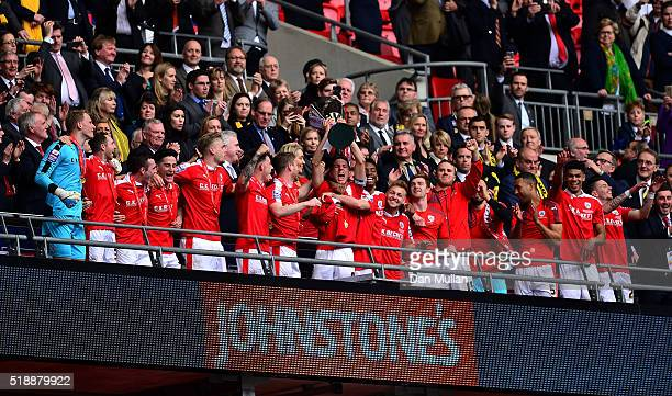 Conor Hourihane of Barnsley lifts the trophy as the Barnsley players celebrate following victory during the Johnstone's Paint Trophy Final between...