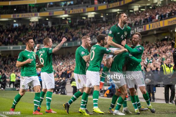 Conor Hourihane of Ireland celebrates scoring with teammates during the UEFA Euro 2020 Qualifying Round Group D match between Republic of Ireland and...