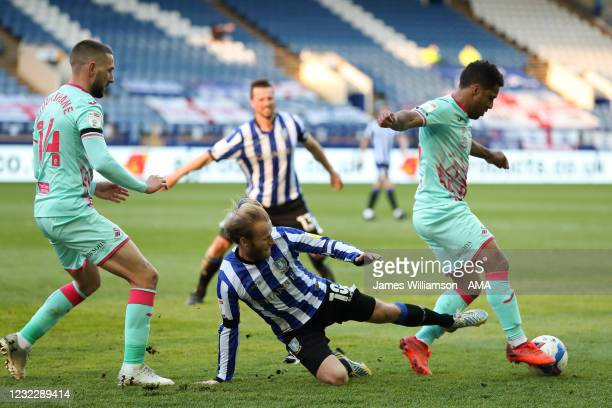 Conor Hourihane of Swansea City and Barry Bannan of Sheffield Wednesday and Wayne Routledge of Swansea City during the Sky Bet Championship match...