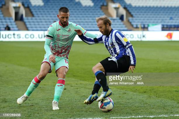 Conor Hourihane of Swansea City and Barry Bannan of Sheffield Wednesday during the Sky Bet Championship match between Sheffield Wednesday and Swansea...
