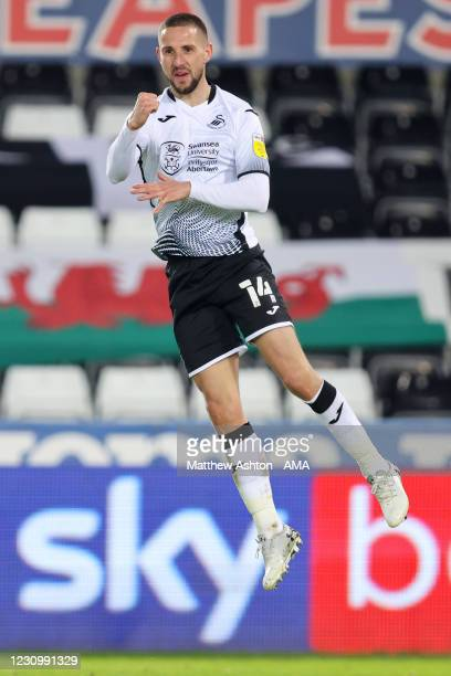 Conor Hourihane of Swansea City celebrates after scoring a goal to make it 2-0 during the Sky Bet Championship match between Swansea City and Norwich...