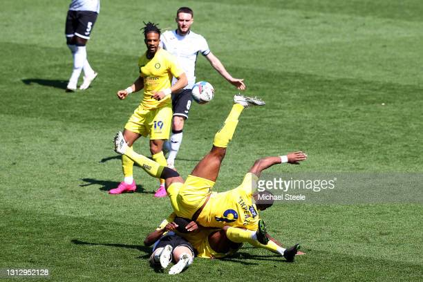 Conor Hourihane of Swansea City finds himself underneath Dennis Adeniran and Uche Ikpeazu of Wycombe Wanderers during the Sky Bet Championship match...