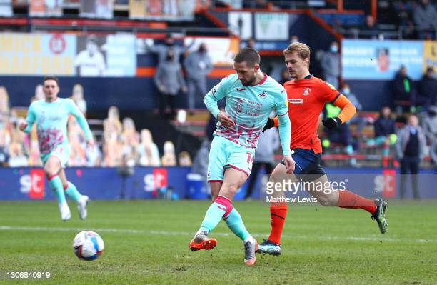 Conor Hourihane of Swansea City scores his team's first goal during the Sky Bet Championship match between Luton Town and Swansea City at Kenilworth...