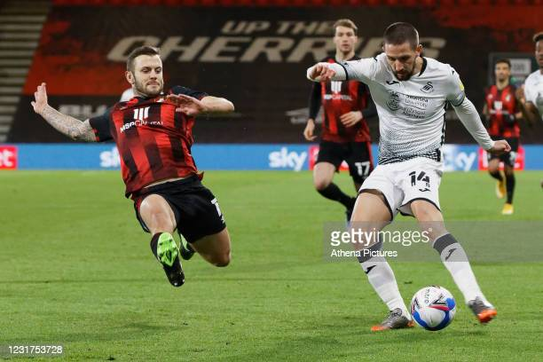 Conor Hourihane of Swansea City takes a shot past Jack Wilshere of Bournemouth during the Sky Bet Championship match between Bournemouth and Swansea...