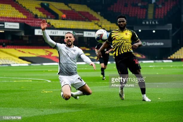 Conor Hourihane of Swansea City under pressure from Isaac Success of Watford during the Sky Bet Championship match between Watford and Swansea City...