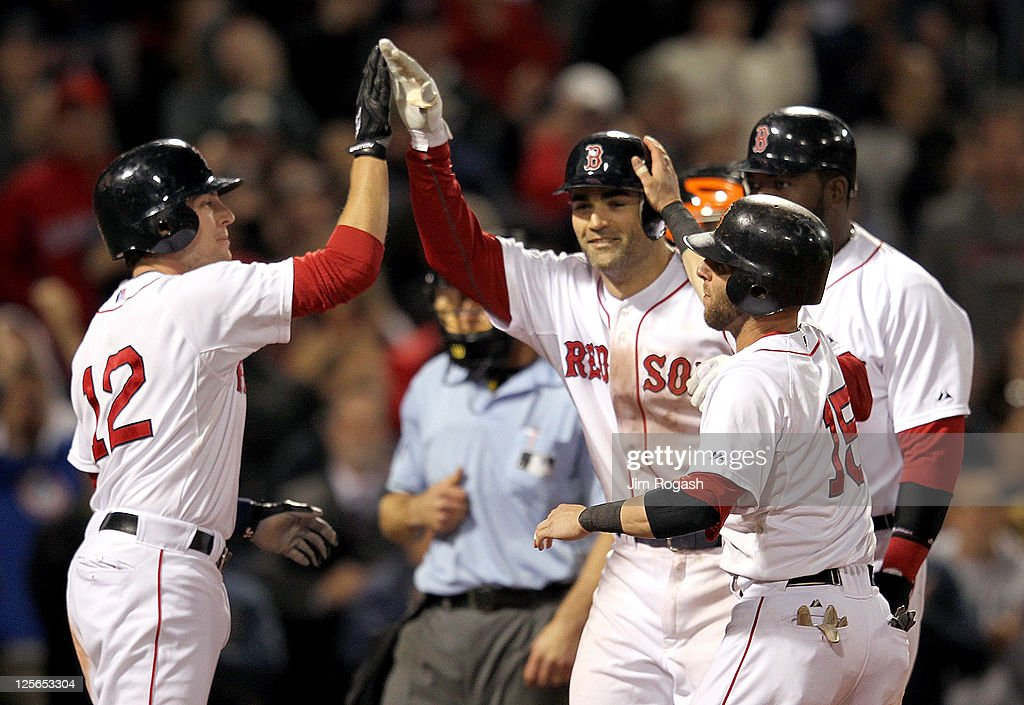 Conor Jackson #36 of the Boston Red Sox celebrates his grand slam with Jed Lowrie #12 of the Boston Red Sox, Dustin Pedroia #15 of the Boston Red Sox, and David Ortiz #34 of the Boston Red Sox during the second game of a doubleheader with the Baltimore Orioles at Fenway Park September 19, 2011 in Boston, Massachusetts.