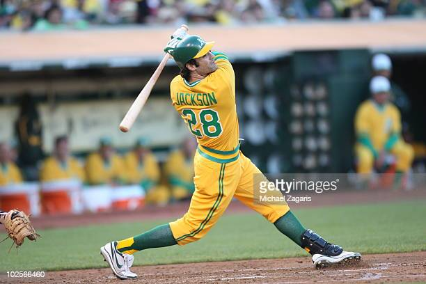 Conor Jackson of the Oakland Athletics batting during the game against the Pittsburgh Pirates during the 1970's themed turn back the clock game at...