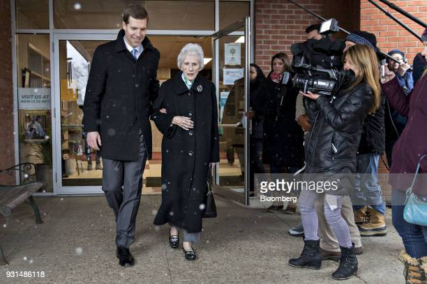 Conor Lamb Democratic candidate for the US House of Representatives walks with his grandmother Barbara Lamb after voting at the Our Lady of Victory...