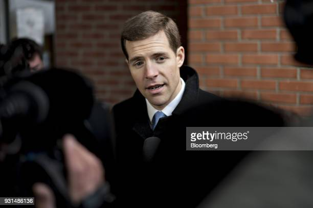 Conor Lamb Democratic candidate for the US House of Representatives speaks to members of the media at the Our Lady of Victory Church polling location...