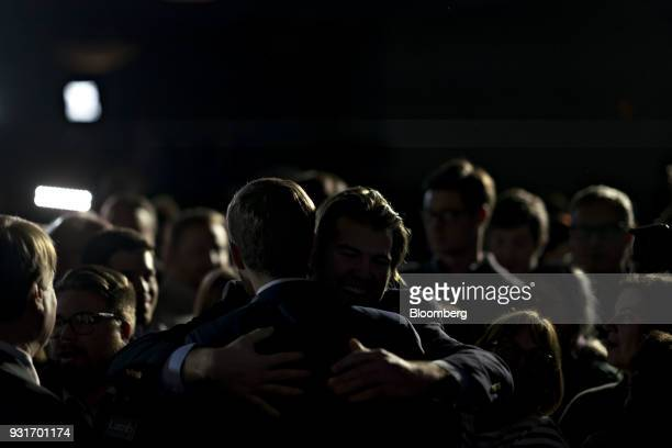 Conor Lamb Democratic candidate for the US House of Representatives center left hugs an attendee during an election night rally in Canonsburg...