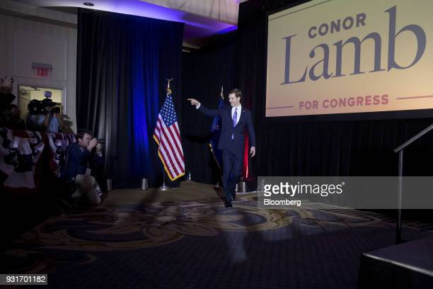 Conor Lamb Democratic candidate for the US House of Representatives gestures as he arrives to speak during an election night rally in Canonsburg...
