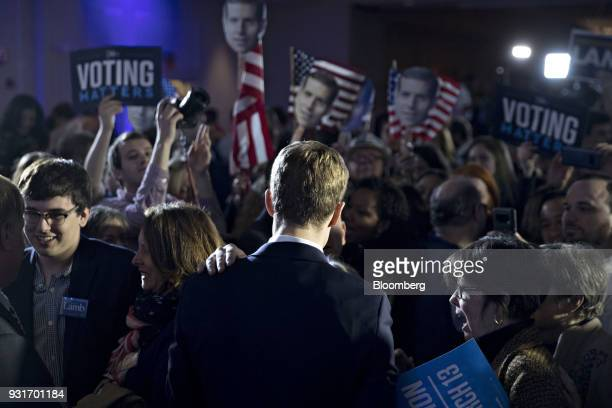 Conor Lamb Democratic candidate for the US House of Representatives center greets attendees after speaking during an election night rally in...